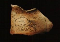 Ostracón con niña soplando horno Caliza 15 cm procedencia desconocida inv nº 1894 din XX